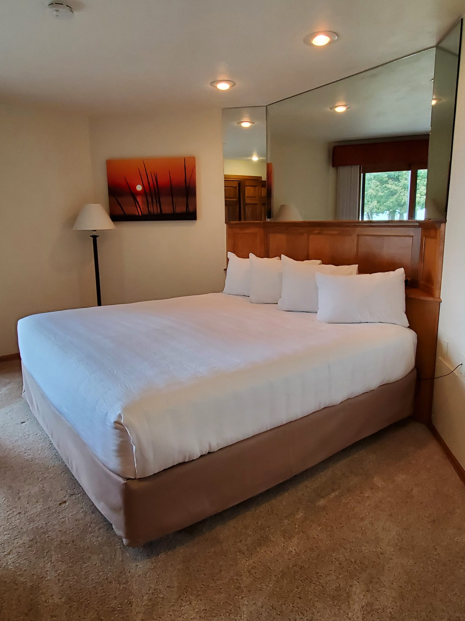 Bedroom with Triple Sheeting at Door County Inn Glidden Lodge