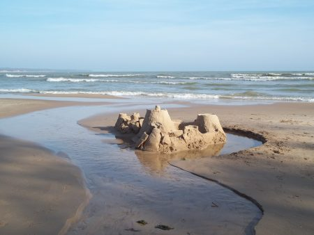Make a Sandcastle on Our Wide Lakefront Beach While Staying in our Door County Hotel Resort