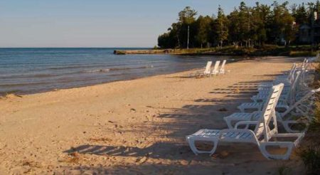 Enjoy Sunsets and Sunrises from our Beachfront Lounge Chairs right outside Our Door County Hotel and Resort