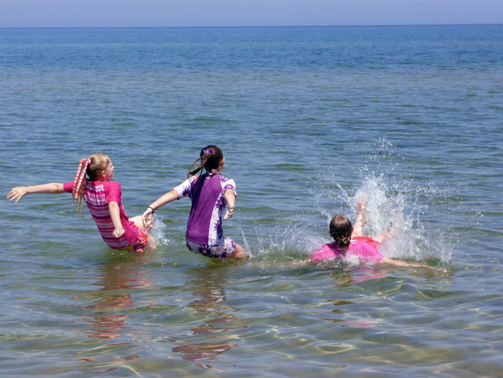 Kids Swimming on Family Vacation at Door County Beach Resort in Sturgeon Bay, WI
