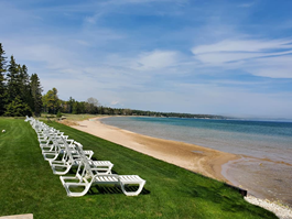 Lake Michigan Waterfront Hotel with Beach Lounge Chairs in Door County, WI